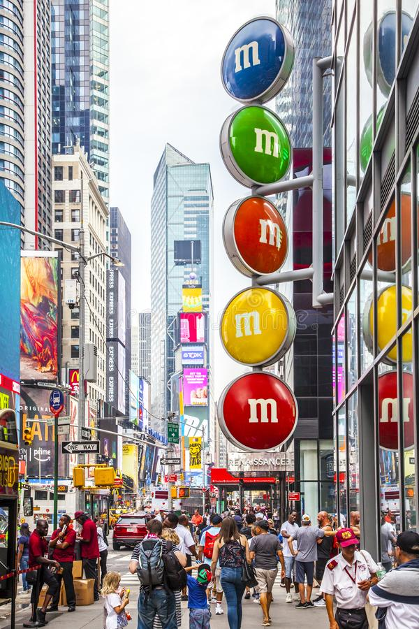 Times Square with tourists and m&m`s street advert stock photos