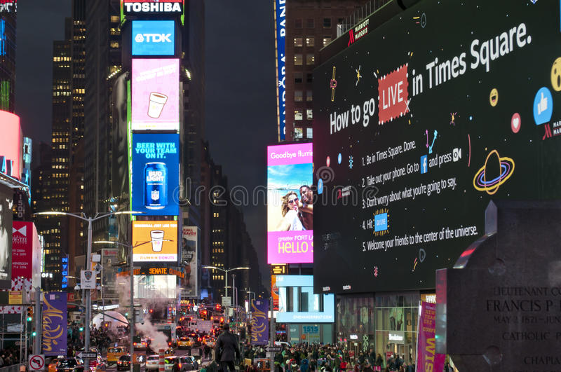 Times square traffic jam and crowd. NEW YORK CITY - DECEMBER 7, 2016: night view of LED signs and people in Times Square on December 7 2016. Times Square is one royalty free stock photography