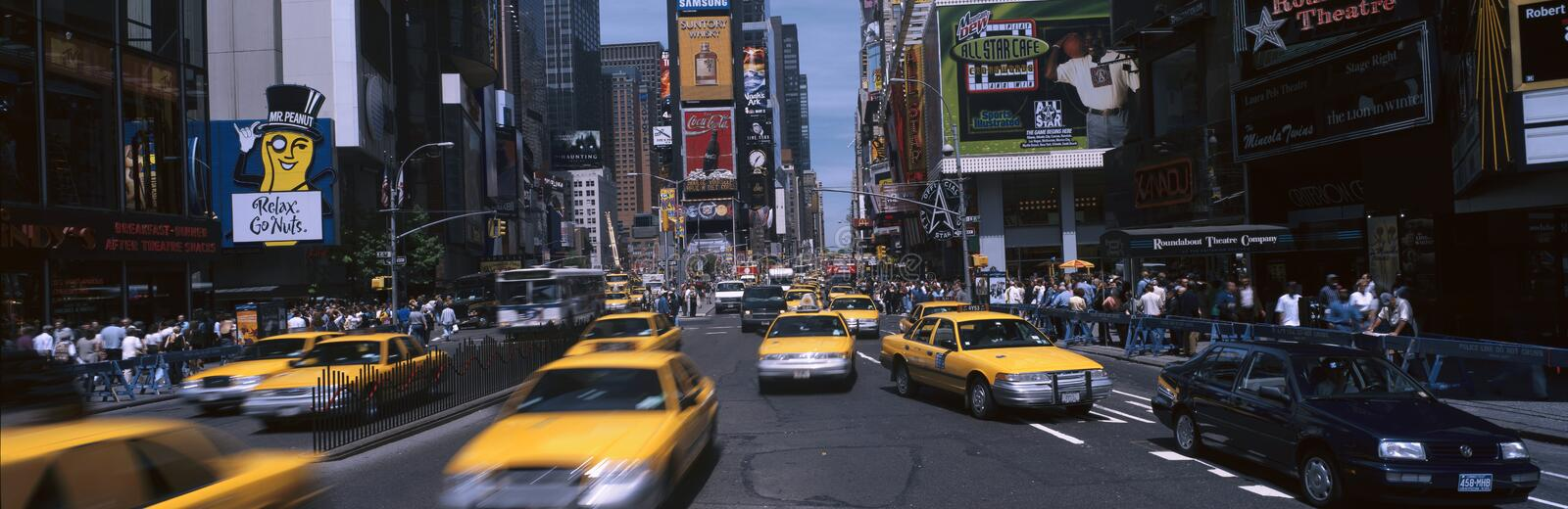 Times Square with yellow taxis during the day royalty free stock photography