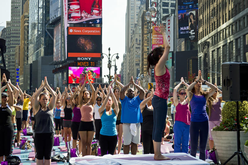 Download Times Square Yoga Class editorial stock image. Image of fitness - 25368864