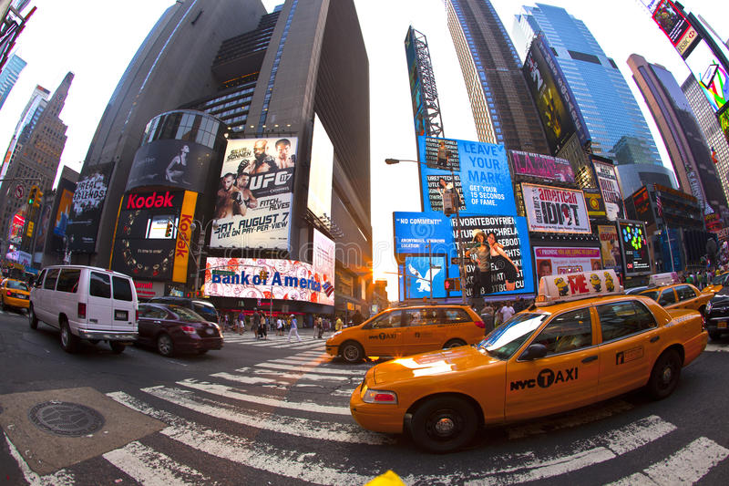 Times Squares is a symbol of New. NEW YORK CITY - JUL 8: Times Square, featured with Broadway Theaters and huge number of LED signs, is a symbol of New York City royalty free stock image