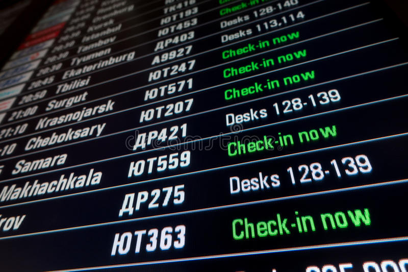 Timetable digital board at an airport royalty free stock photo