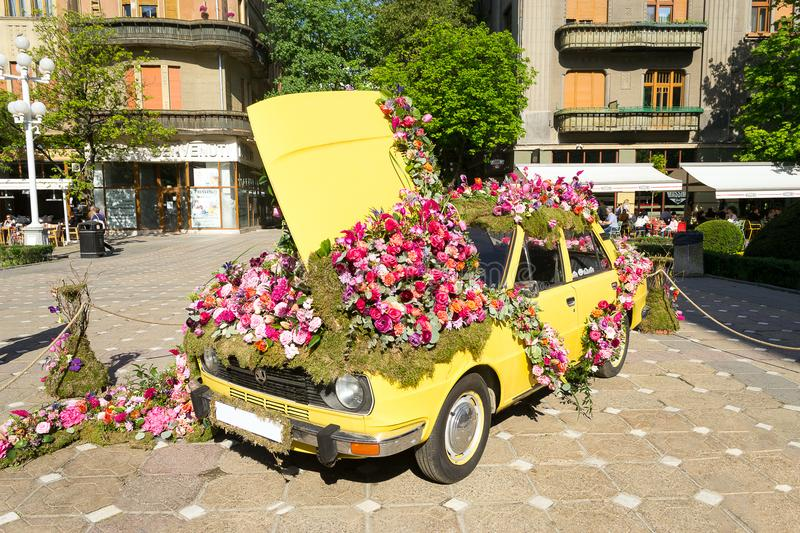 Timfloralis - Flowers Festival, Timisoara, Romania. Beautiful floral decoration of a yellow vintage Skoda car - Timfloralis - Flowers Festival, Timisoara royalty free stock image