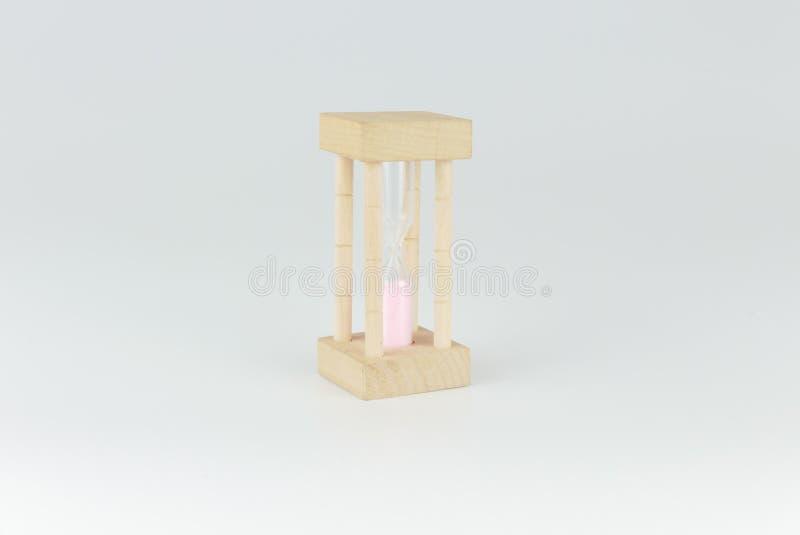 Timglas- eller sandklocka som isoleras på grå bakgrund arkivfoton