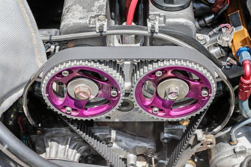Timing belt and camshaft sprocket in engine. stock images