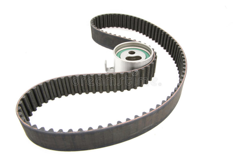 Timing belt isolated. (with clipping path) tensioner pulley stock photo