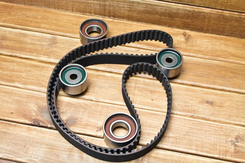 Timing belt with rollers on background .Kit of timing belt for car engine stock photos