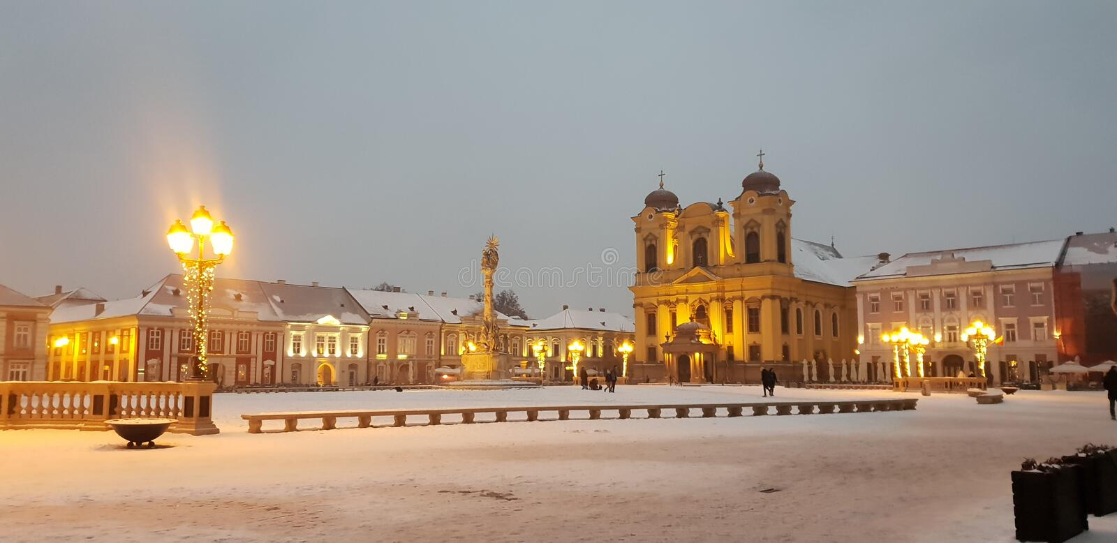Timisoara covered in snow in winter time Union square unirii. Timisoara covered snow winter time union square unirii royalty free stock images