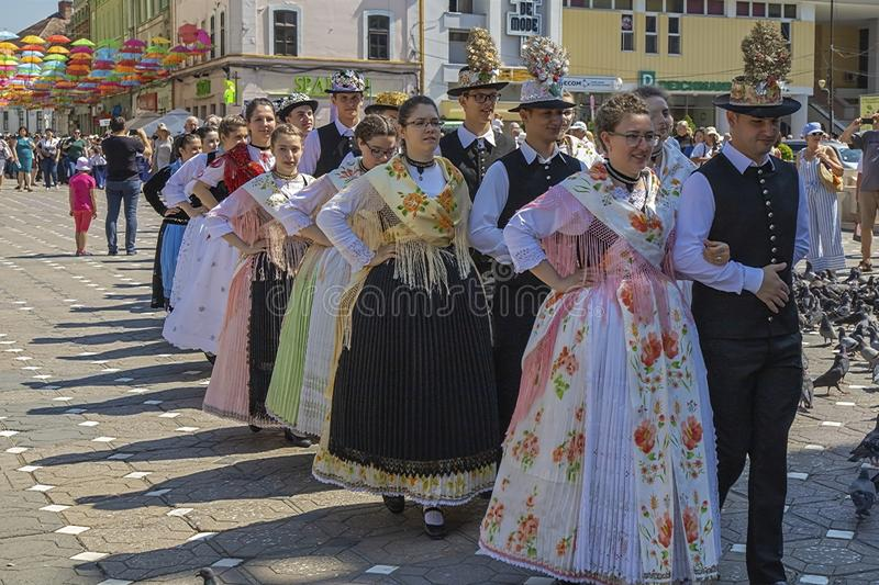 Parade of the Swabian folk costumes, Timioara, Romania. TIMISOARA, ROMANIA - JUNE 16, 2019: The parade of the Swabian folk costumes on the occasion the days of royalty free stock photography