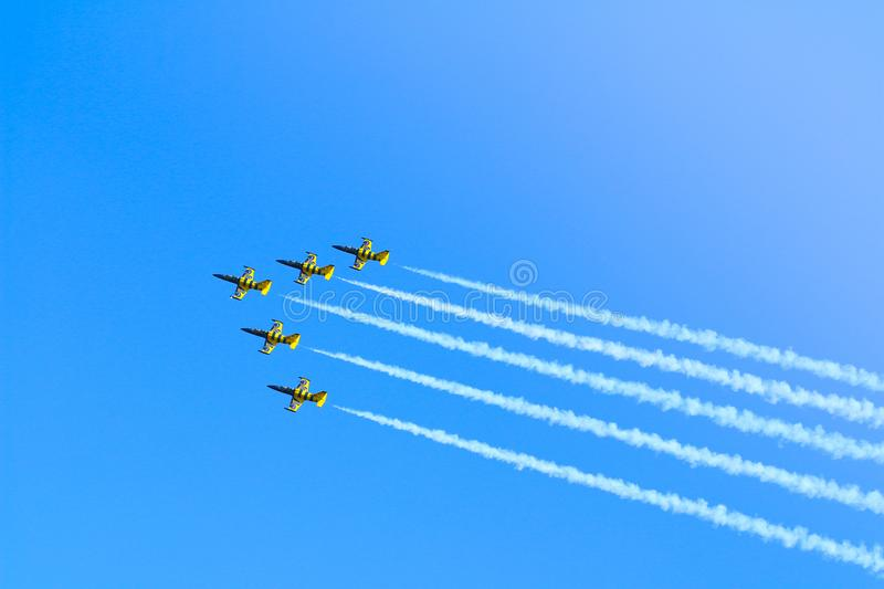 L-39C Albatros aerobatic airplanes by Baltic Bees Jet Team performing a demonstration flight at Timisoara Airshow royalty free stock photos