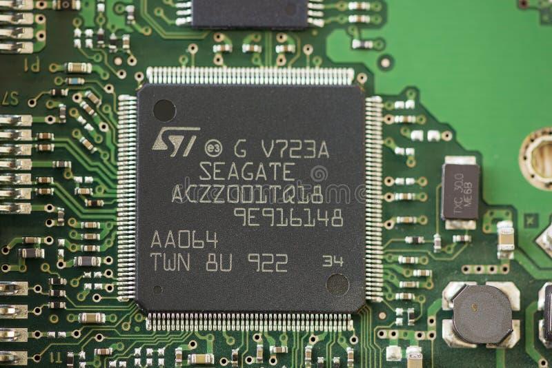 Close-up of a microprocessor. TIMISOARA, ROMANIA - MARCH 30, 2019: Close-up of a Seagate microprocessor. Micro controller royalty free stock photos
