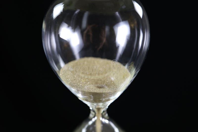 Timmeexponeringsglas - tid är pengarbegrepp royaltyfria foton
