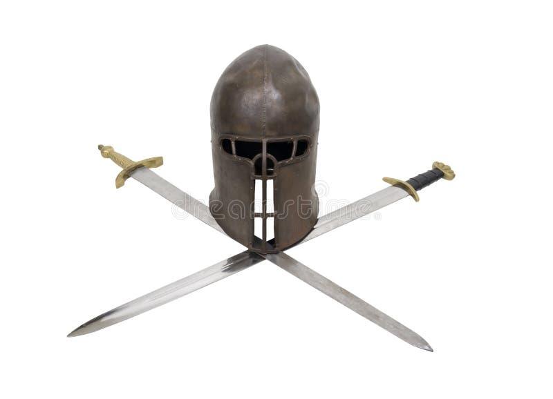 Timone medioevale e spade attraversate fotografia stock