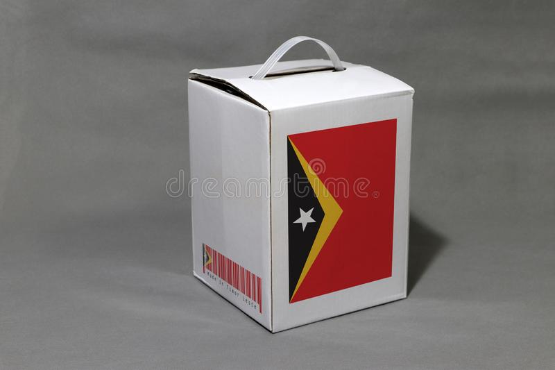Timor flag on white box with barcode and the color of nation flag. The concept of export trading from Timor Leste. Paper packaging for put products royalty free stock image