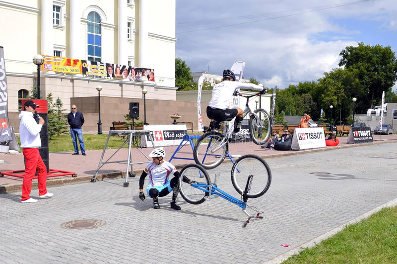Timur Ibragimov and Mikhail Sukhanov's performance, champions of. Russia on a cycle trial. City Day of Tyumen on July 26, 2014 stock photos