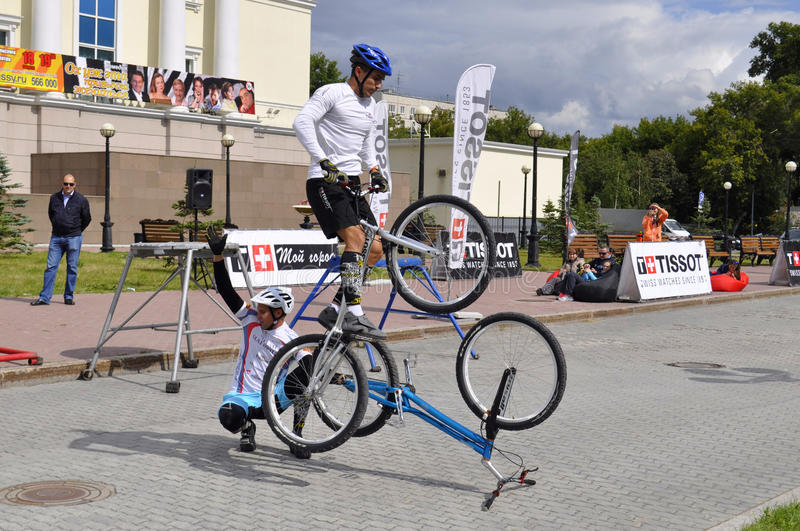 Timur Ibragimov and Mikhail Sukhanov's performance, champions of. Russia on a cycle trial. City Day of Tyumen on July 26, 2014 royalty free stock photos