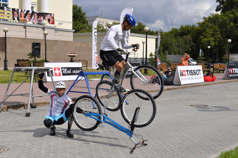 Timur Ibragimov and Mikhail Sukhanov's performance, champions of. Russia on a cycle trial. City Day of Tyumen on July 26, 2014 royalty free stock photography