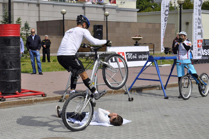 Timur Ibragimov and Mikhail Sukhanov's performance, champions of. Russia on a cycle trial. City Day of Tyumen on July 26, 2014 royalty free stock image
