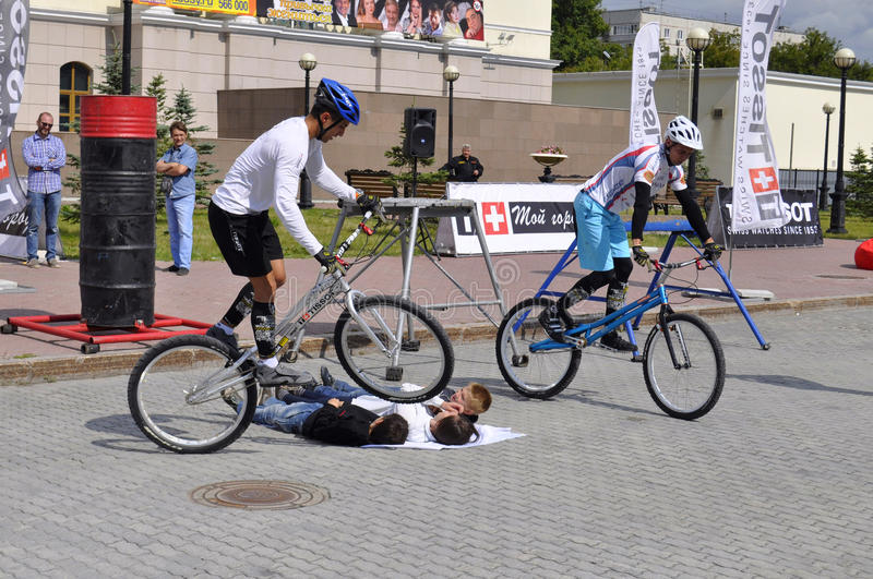 Timur Ibragimov and Mikhail Sukhanov's performance, champions of. Russia on a cycle trial. City Day of Tyumen on July 26, 2014 stock images