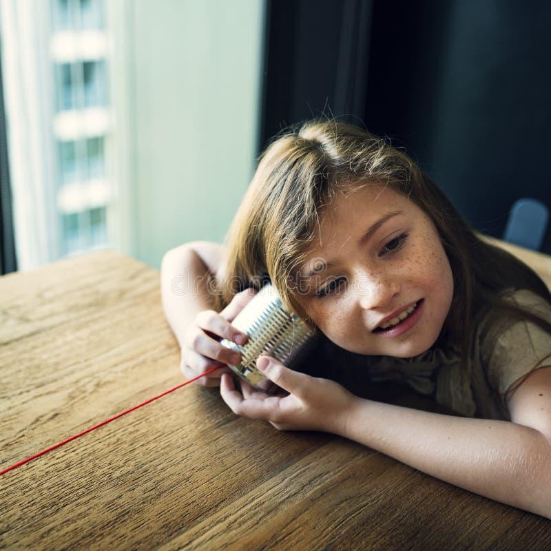 Tin Can Phone Girl Concept fotografía de archivo