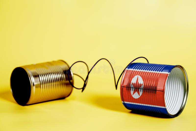 Tin can phone with North Korea Flag.communication concept stock image