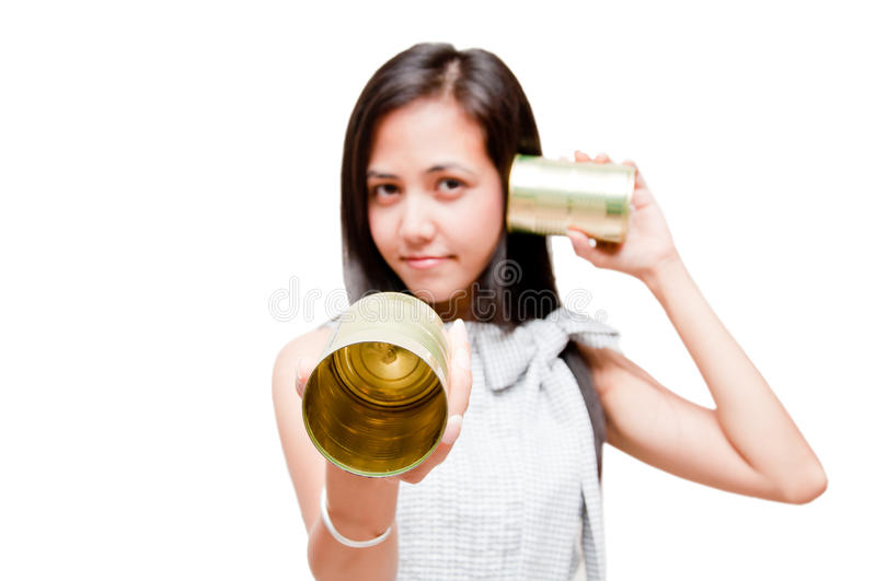 Tin can phone woman royalty free stock photography
