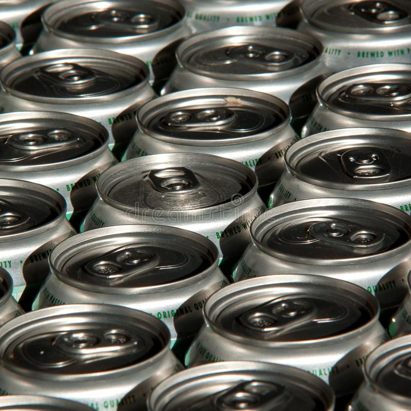 Tin cans with water, beer. Several tin cans with water or booze densely standing in the package stock photo