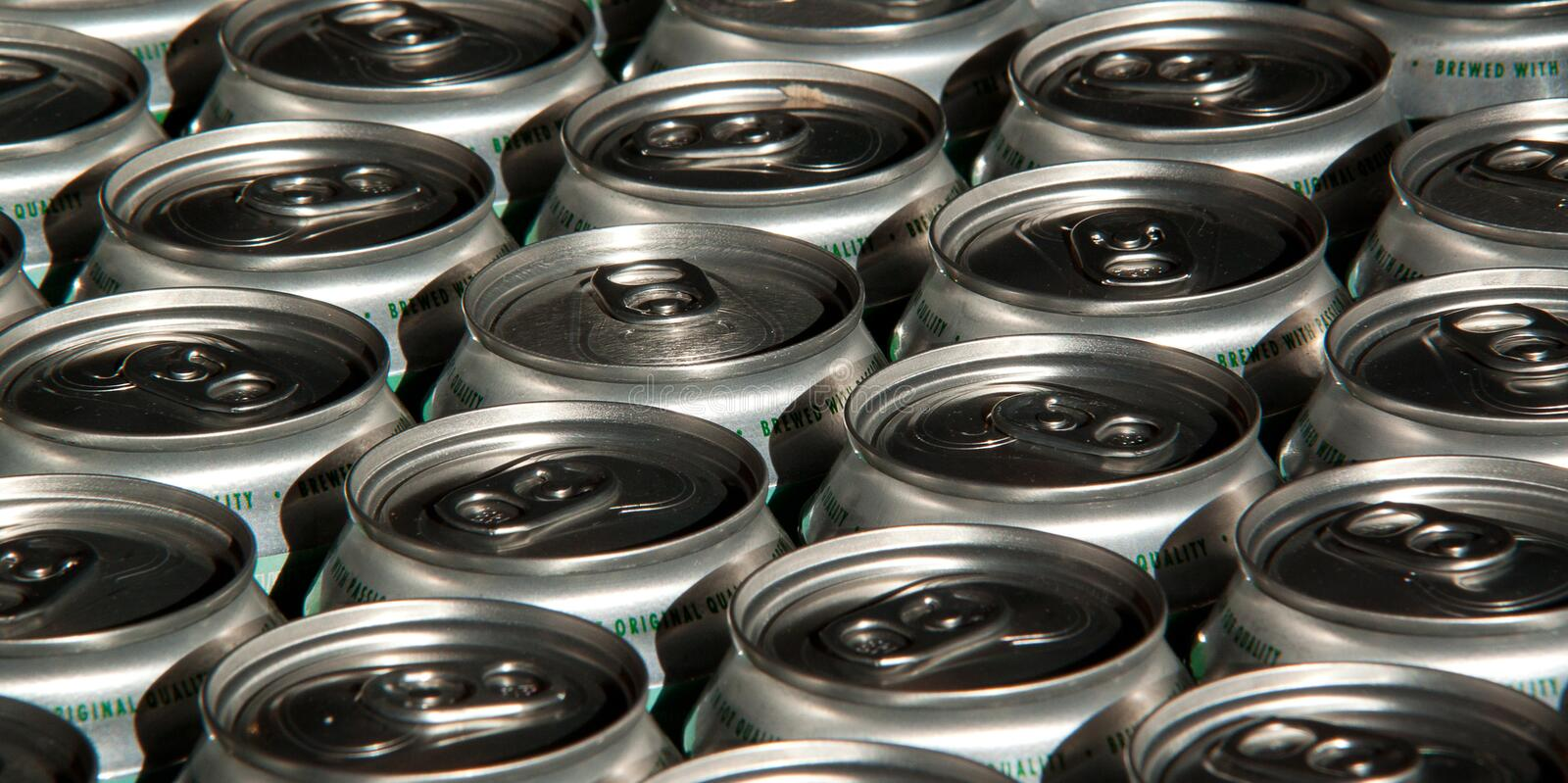 Tin cans with water, beer. Several tin cans with water or booze densely standing in the package stock photos