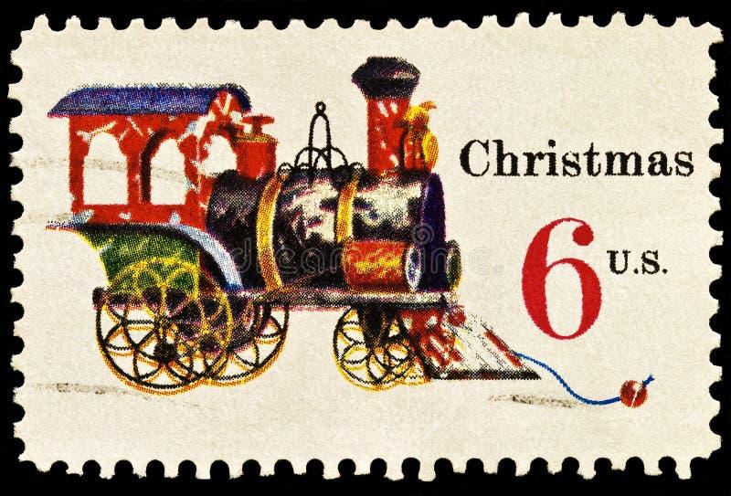 Tin and Cast Iron Locomotive Christmas Stamp stock image