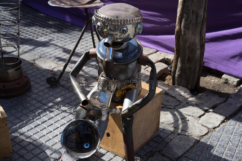Tin man playing the saxaphone on the street stock images