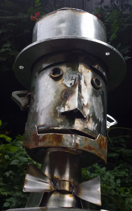 Tin Man. Silver colored Tin Man head reminiscent of the Wizard of Oz) constructed of turned and shaped metal stock images