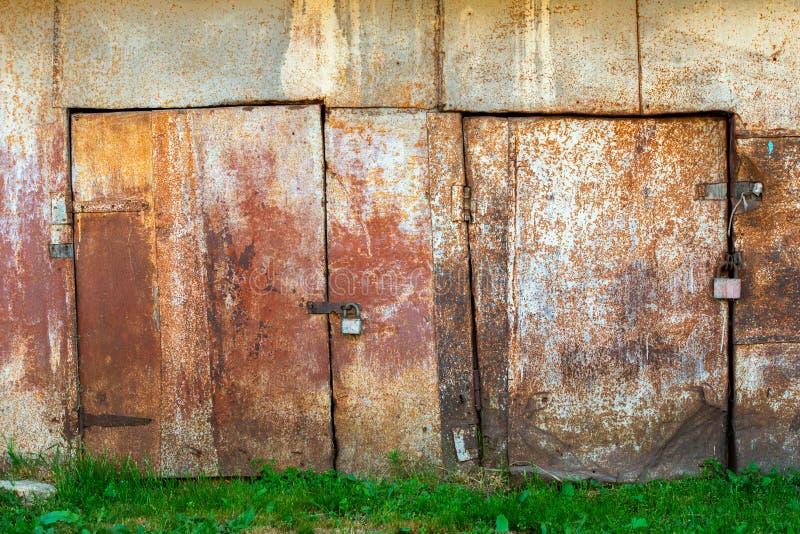 Tin metal barn doors. Rusted painted white tin metal closed barn doors stock image