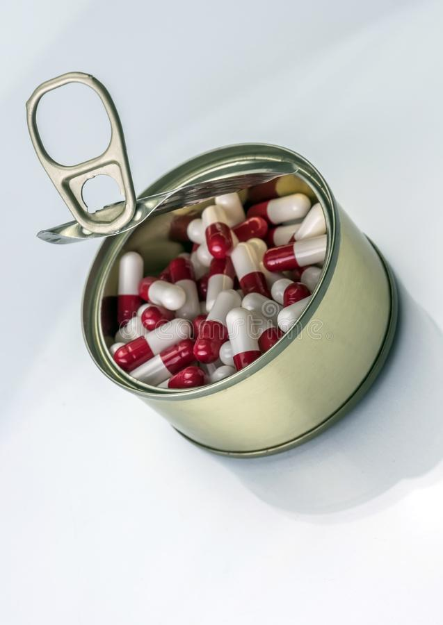 Tin metal contains white pills and red. Conceptual image stock images
