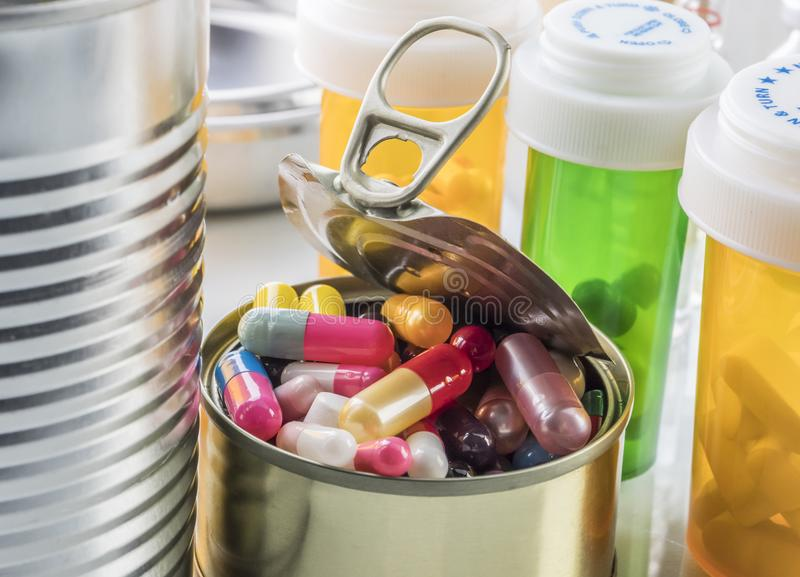 Tin metal contains white pills and red. Conceptual image royalty free stock image