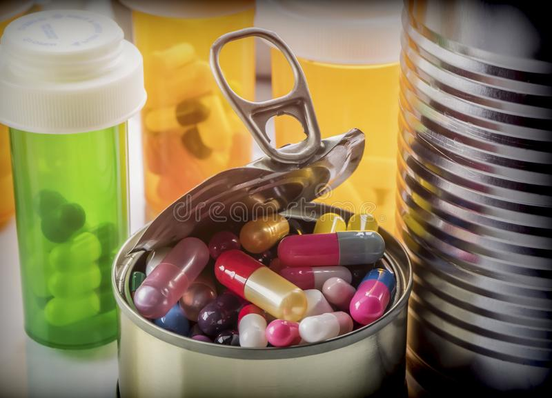 Tin metal contains white pills and red,. Conceptual image royalty free stock photos