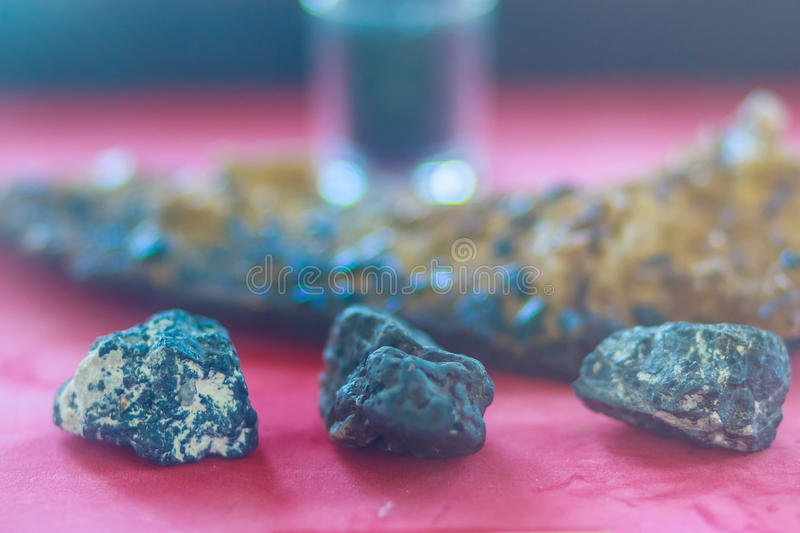 Tin ore in the rock specimen. Natural tin mineral sample for education. royalty free stock image