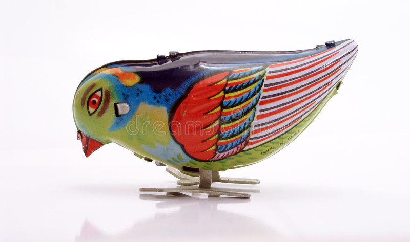 Tin-Toy Series – Pecking Blue Bird royalty free stock photography