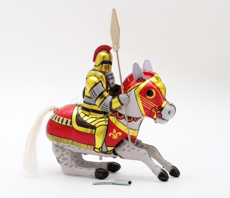 Tin-Toy Series - cavaliere Riding un cavallo immagini stock libere da diritti