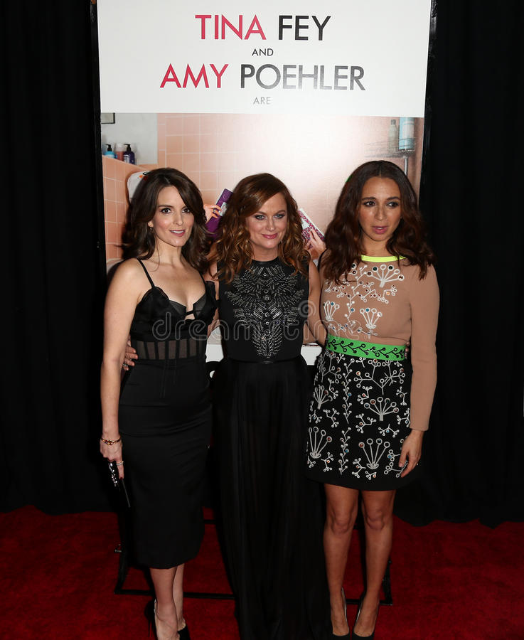 Tina Fay, Amy Poehler, Maya Rudolph. NEW YORK-DEC 8: Actresses Tina Fay, Amy Poehler, Maya Rudolph attend the premiere of Sisters at the Ziegfeld Theatre on royalty free stock photo