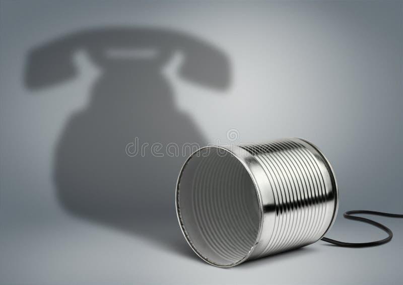 Tinblik met telefoonschaduw, communicatie creatief concept stock foto's