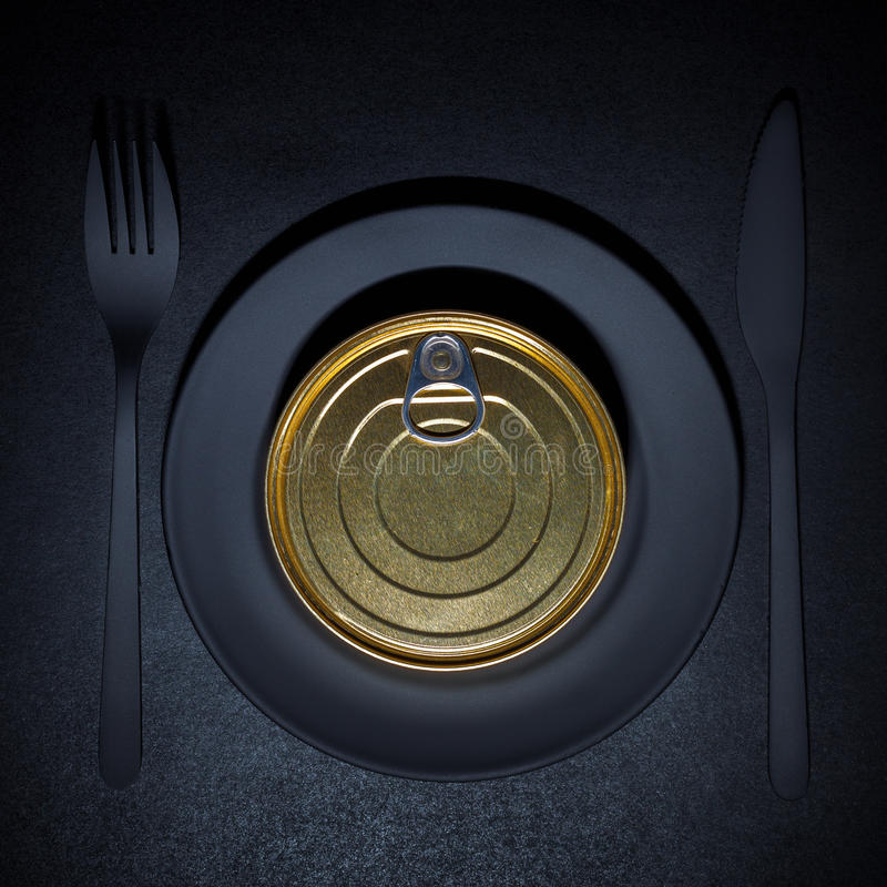 Tincan. On a black plate royalty free stock photos