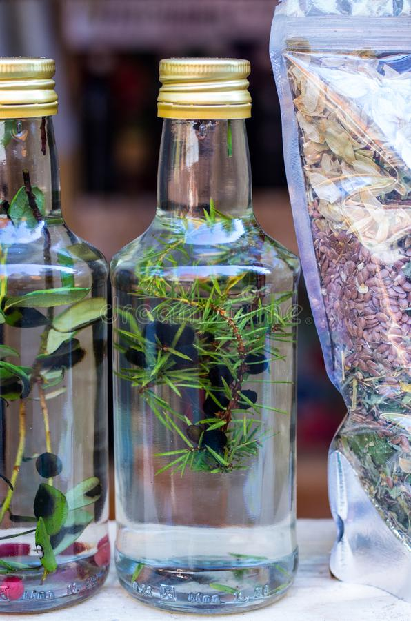 Tincture of juniper. Homemade alcoholic beverage. Home remedy. stock photo