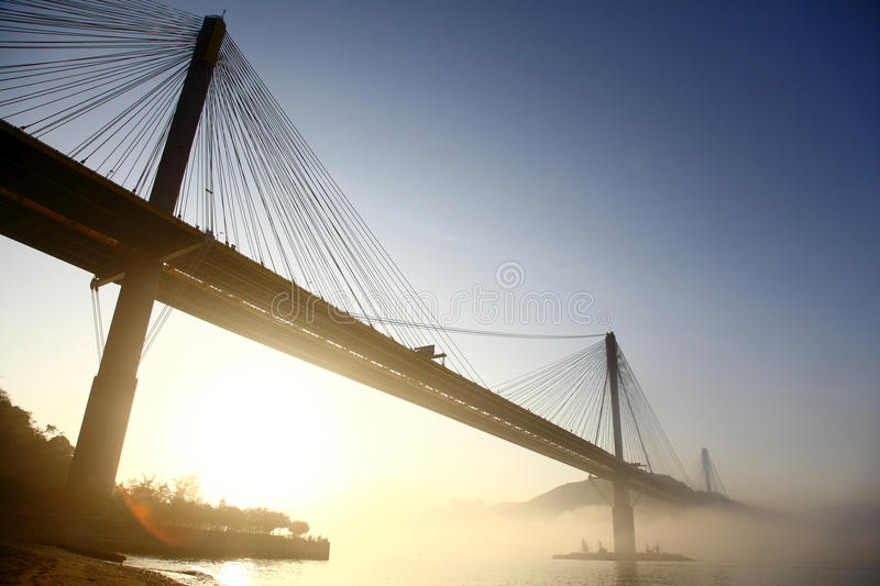 Ting Kau Bridge. Within sunrises and haze.  is a 1,177-metre long cable-stayed bridge in Hong Kong that spans from the northwest of Tsing Yi Island and Tuen Mun royalty free stock photos