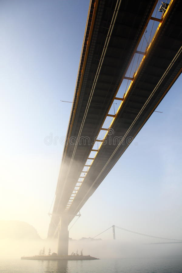 Ting Kau Bridge. Within sunrises and haze.  is a 1,177-metre long cable-stayed bridge in Hong Kong that spans from the northwest of Tsing Yi Island and Tuen Mun stock images
