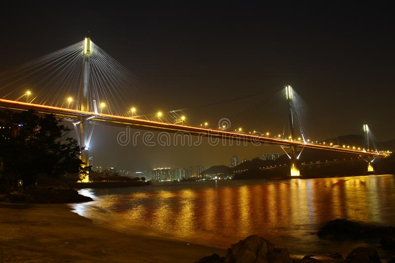 Ting Kau Bridge in Hong Kong - across the golden color sea. Ting Kau Brdige is the longest cable-stayed bridge in Hong Kong. Photo was taken at night with golden stock image