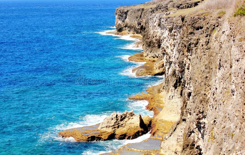 Tinian cliff sides. The cliff sides at the Suicide Cliff is one of the tourist attractions on the island of Tinian, Northern Mariana Islands stock photography