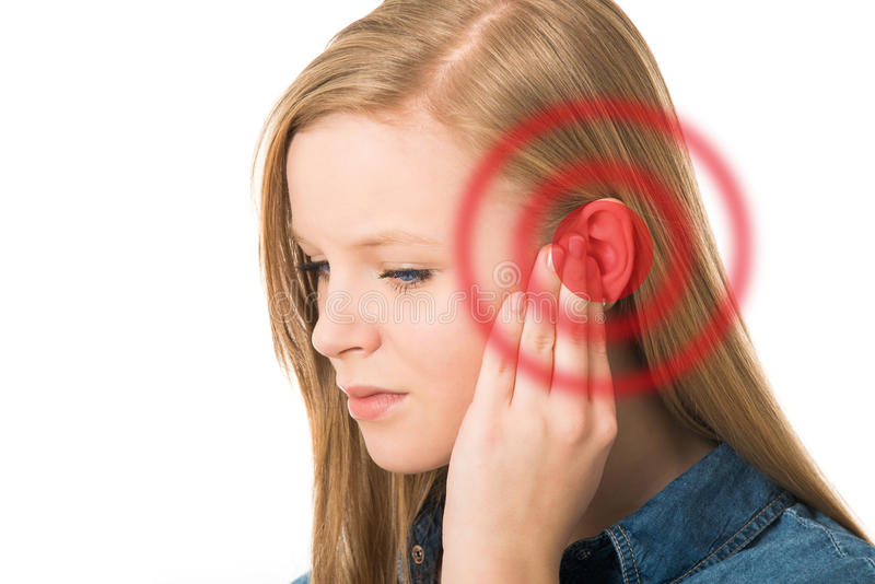 Tinnitus. Girl holds hand on your ear stock images