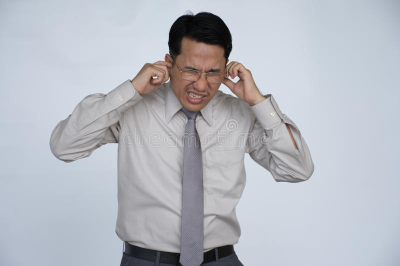 Tinnitus. Closeup up side profile sick male having ear pain touching his painful head isolated on White background stock photos
