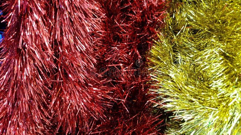 Tinsel υπόβαθρο για τα Χριστούγεννα, καλή χρονιά στοκ φωτογραφία