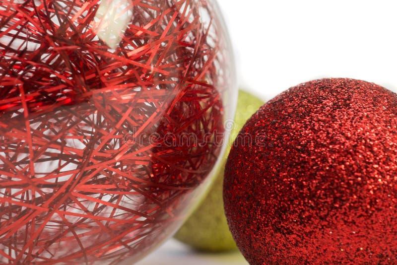 Tinsel Baubels. Christmas Baubels in red and gold shimering and shining stock photo